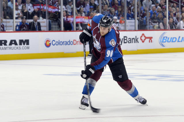 Colorado Avalanche center Ryan O'Reilly (90) shoots a goal against the Minnesota Wild during the second period in Game 1 of an NHL hockey first-round playoff series on Thursday, April 17, 2014, in Denver. (AP Photo/Jack Dempsey)