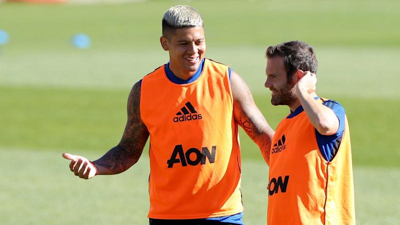 Marcos Rojo (L) has joined Argentina's Estudiantes after more than five years at Manchester United