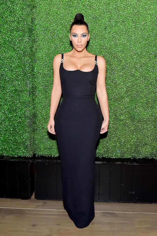 <p>At the KKWxMario Dinner, after returning to her brunette locks, Kim wore a tight-fitting black dress.<em> [Photo: Getty]</em> </p>