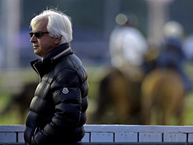 Trainer Bob Baffert watches morning workouts at Churchill Downs Thursday, May 1, 2014, in Louisville, Ky. (AP Photo/Charlie Riedel)