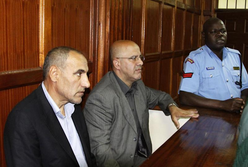 """Kenyan police escort two Iranian nationals Ahmed Abolfathi Mohammed, centre, and Sayed Mansour Mousavi, left, as they await judgement inside the magistrate court in Nairobi, Kenya, Monday, May 6, 2013.  The two men were convicted of plotting attacks against western and Israeli targets, to life in prison.  The two Iranian nationals Ahmad Abolfathi Mohammad and Sayed Mansour Mousavi were arrested in June 2012, and prosecutors said the two had explosives """"in circumstances that indicated they were armed with the intent to commit grievous harm, and they are suspected of involvement in attacks, or thwarted attacks, around the globe, including in Azerbaijan, Thailand and India.  (AP Photo/Khalil Senosi)"""
