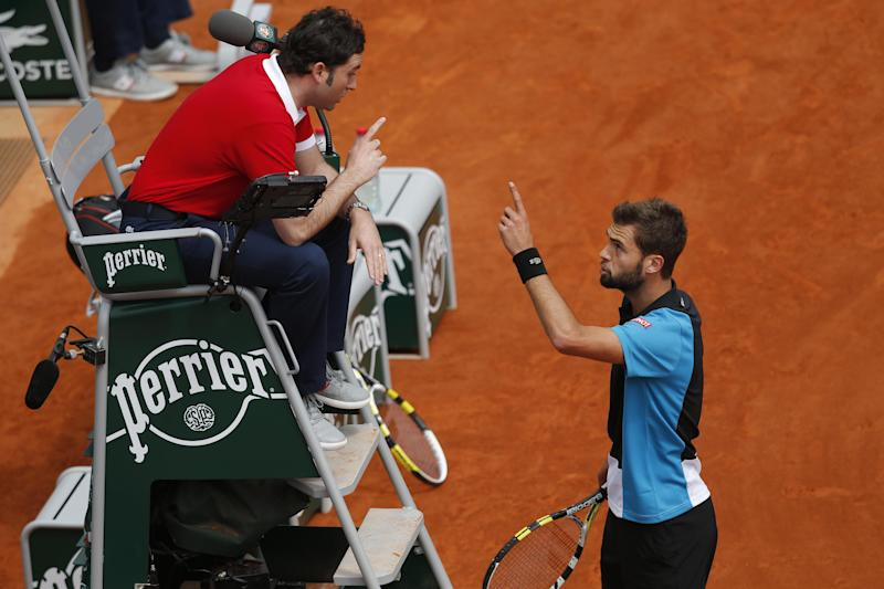 Benoit Paire of France, right, argues with umpire Enric Molina of Spain, left, in his third round match against Japan's Kei Nishikori at the French Open tennis tournament, at Roland Garros stadium in Paris, Saturday, June 1, 2013. Paire was given a penalty point. (AP Photo/Christophe Ena)