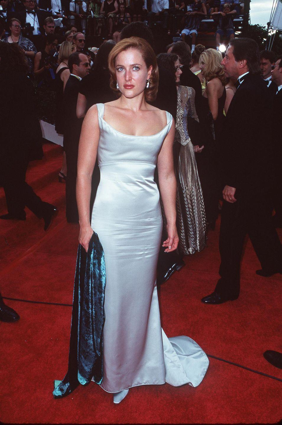 <p><em>The X-Files</em> star wore a form-fitting column with a velvet shawl on the red carpet. Later this night she won Lead Actress in a Drama Series for her role in the show. </p>