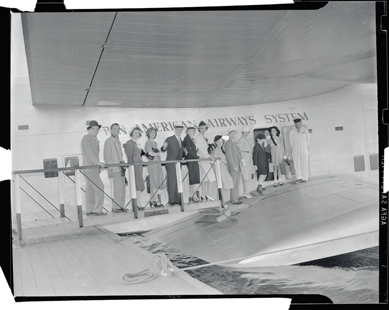 Passengers boarding Pan American clipper ship at Port Washington, NY circa 1939.