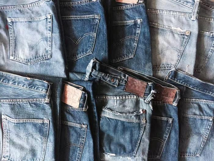 A group of distressed Levi's jeans.