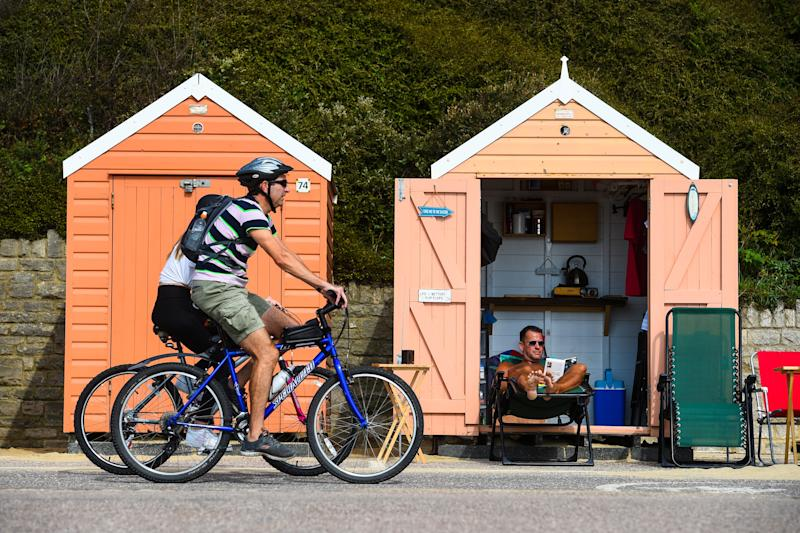 Stuart Henderson enjoys the Autumn sunshine from his beach hut on Bournemouth beach.