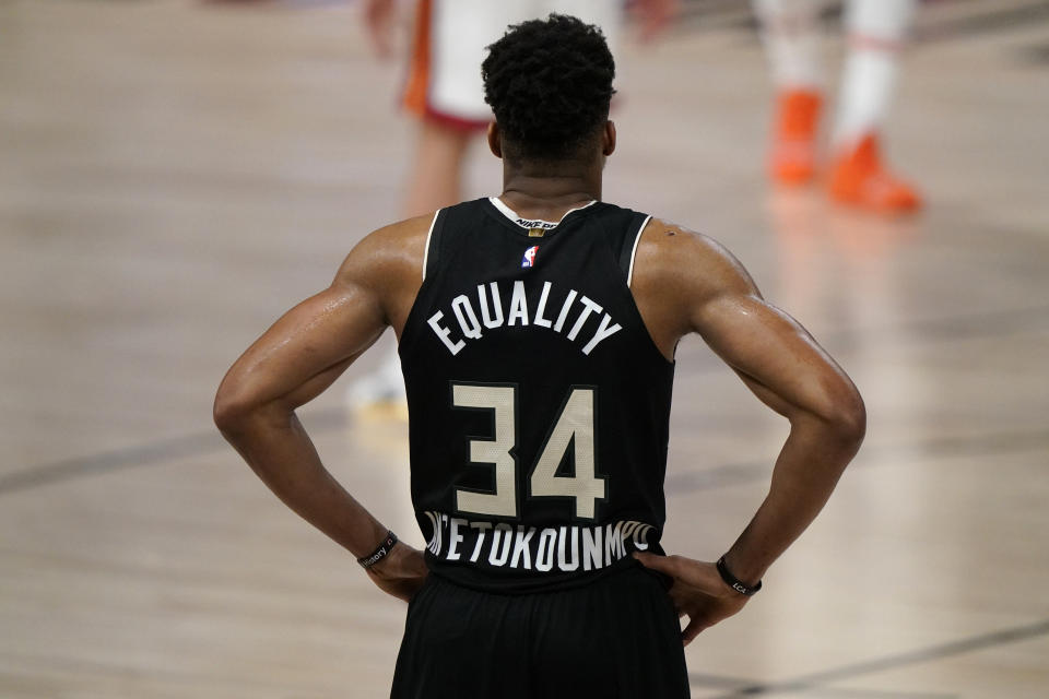 Milwaukee Bucks' Giannis Antetokounmpo (34) stands on the court during the second half of an NBA conference semifinal playoff basketball game against the Miami Heat, Wednesday, Sept. 2, 2020, in Lake Buena Vista, Fla. (AP Photo/Mark J. Terrill)