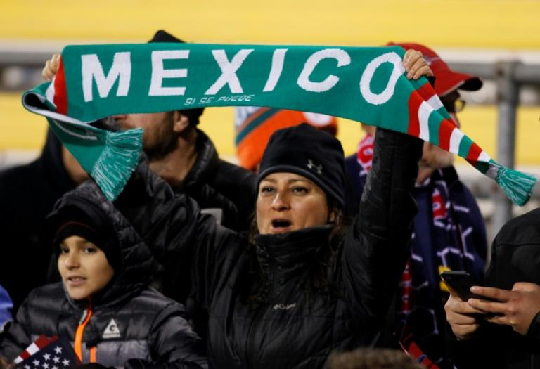 Mexico soccer fans cheer during the second half of a 2018 FIFA World Cup qualifying match between the Mexico men's national team and the US men's national team in Columbus, Ohio on November 11, 2016