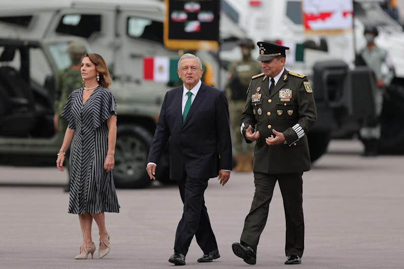 VARIOUS CITIES, MEXICO - SEPTEMBER 16: President Andres Manuel Lopez Obrador and his wife Beatriz Gutierrez Muller walk during the Independence Day military parade at Zocalo Square on September 16, 2020 in Various Cities, Mexico. This year El Zocalo remains closed for general public due to coronavirus restrictions. Every September 16 Mexico celebrates the beginning of the revolution uprising of 1810. (Photo by Hector Vivas/Getty Images)