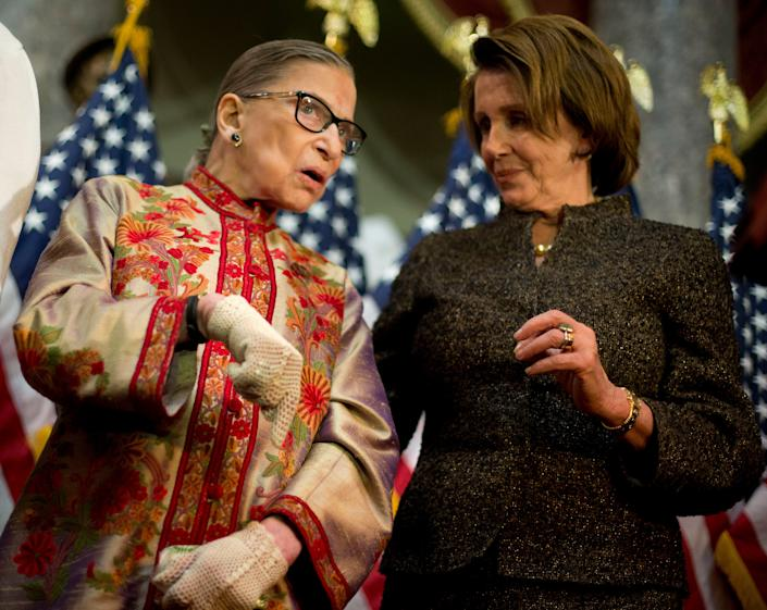 House Minority Leader Nancy Pelosi of Calif. right, talks with Supreme Court, Associate Justice Ruth Bader Ginsburg during her annual Women's History Month reception, Wednesday, March 18, 2015, in Statuary Hall on Capitol Hill in Washington. Pelosi was honoring the women Justices of the U.S. Supreme Court.