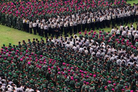 Indonesian military and police personnel attend a security briefing ahead of Jakarta's gubernatorial election in Jakarta, Indonesia April 18, 2017 in this photo taken by Antara Foto. Antara Foto/Rivan Awal Lingga/via REUTERS