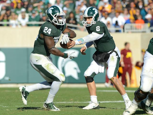 Could Le'Veon Bell be following the free-agent path that Kirk Cousins, his former collegiate teammate at Michigan State, set last offseason? (Getty Images)