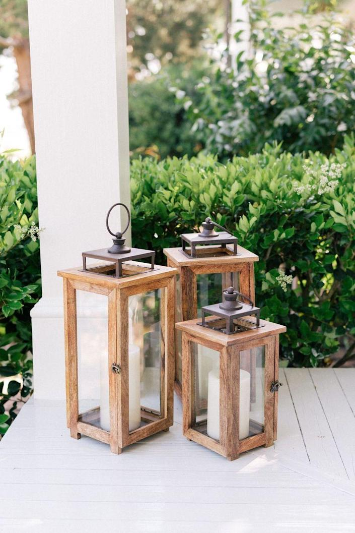 """<p>Give your outdoor space a nostalgic feel with these old-timey lanterns. They're practical, too, bringing light to darker areas of your porch and yard.</p><p><strong>See more at <a href=""""https://galmeetsglam.com/2018/05/front-porch-makeover/"""" rel=""""nofollow noopener"""" target=""""_blank"""" data-ylk=""""slk:Julia Berolzheimer"""" class=""""link rapid-noclick-resp"""">Julia Berolzheimer</a>.</strong></p><p><strong><a class=""""link rapid-noclick-resp"""" href=""""https://go.redirectingat.com?id=74968X1596630&url=https%3A%2F%2Fwww.walmart.com%2Fsearch%2F%3Fquery%3Dwooden%2Blanterns&sref=https%3A%2F%2Fwww.thepioneerwoman.com%2Fhome-lifestyle%2Fdecorating-ideas%2Fg36732301%2Foutdoor-fall-decorations%2F"""" rel=""""nofollow noopener"""" target=""""_blank"""" data-ylk=""""slk:SHOP WOODEN LANTERNS"""">SHOP WOODEN LANTERNS</a></strong></p>"""