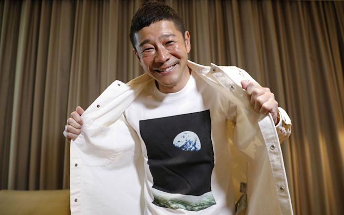 Japanese billionaire Yusaku Maezawa poses with his T-shirt bearing an image of Earth  - KIM KYUNG-HOON /REUTERS