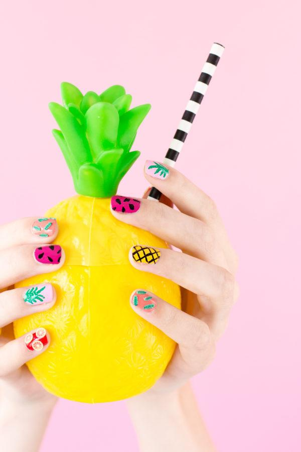 """<p>Give yourself a tropical manicure to get yourself in the summer spirit.<i><a href=""""http://studiodiy.com/2016/05/10/diy-tropical-fruit-manicure/""""> [Photo: Studio DIY]</a></i></p>"""