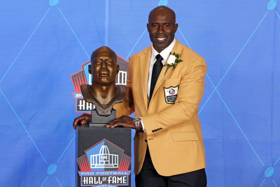 Terrell Davis poses with a bust of him during inductions at the Pro Football Hall of Fame on Saturday, Aug. 5, 2017, in Canton, Ohio. (AP Photo/Gene J. Puskar)