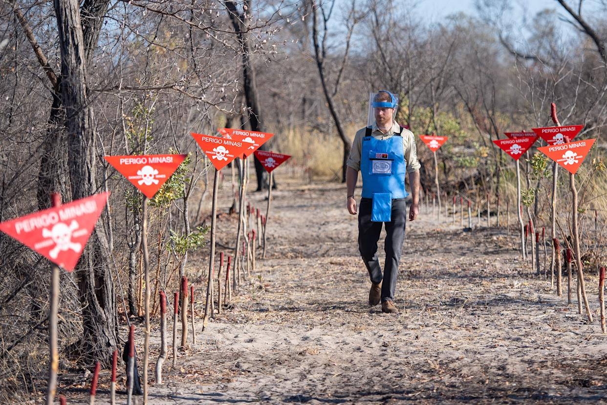 The Duke of Sussex walks through a minefield in Dirico, Angola, during a visit to see the work of landmine clearance charity the Halo Trust, on day five of the royal tour of Africa.  [Photo: PA]