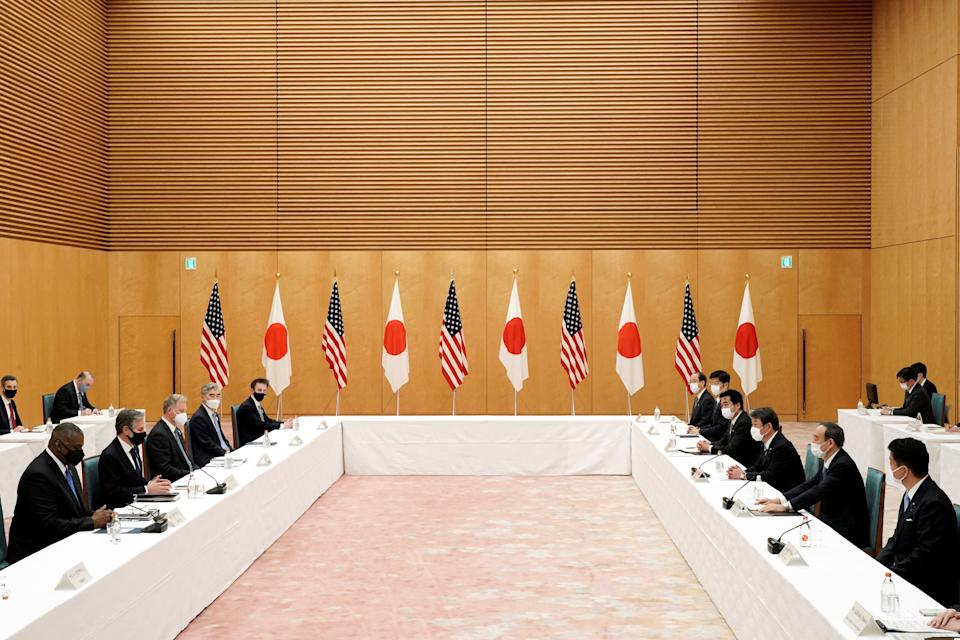 US Secretary of State Antony Blinken (2nd L) and Defense Secretary Lloyd Austin (L) meet with Japan's Prime Minister Yoshihide Suga (2nd R) during a courtesy call at the prime minister's office in Tokyo on March 16, 2021. (Photo by Eugene Hoshiko / POOL / AFP) (Photo by EUGENE HOSHIKO/POOL/AFP via Getty Images)