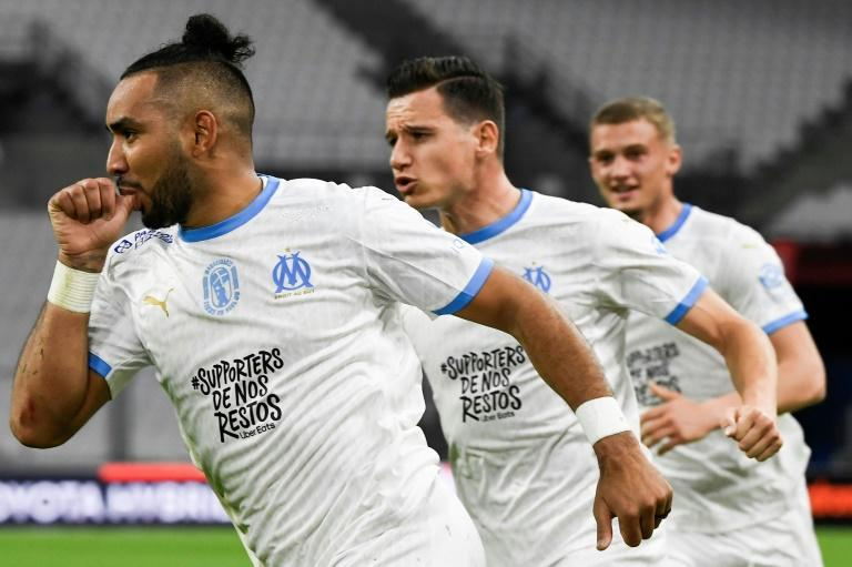 Dimitri Payet celebrates with Florian Thauvin and Michael Cuisance after scoring in Marseille's 3-1 win over Nantes
