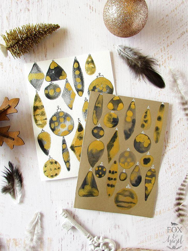 """<p>Christmas isn't all about the reds and greens, you know! Here, black and gold take center stage for a look that's as sophisticated as it is fun.</p><p><strong>Get the tutorial at <a href=""""https://www.foxandhazel.com/diy-black-gold-watercolour-ornament-cards/"""" rel=""""nofollow noopener"""" target=""""_blank"""" data-ylk=""""slk:Fox and Hazel"""" class=""""link rapid-noclick-resp"""">Fox and Hazel</a>.</strong></p><p><a class=""""link rapid-noclick-resp"""" href=""""https://www.amazon.com/Krylon-K09901A00-Leafing-Gold-Ounce/dp/B003ZTNENS/ref=sr_1_2?tag=syn-yahoo-20&ascsubtag=%5Bartid%7C10050.g.3872%5Bsrc%7Cyahoo-us"""" rel=""""nofollow noopener"""" target=""""_blank"""" data-ylk=""""slk:SHOP GOLD PAINT PEN""""><strong>SHOP GOLD PAINT PEN</strong> </a></p>"""