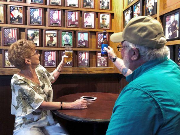 PHOTO: Debra and Ray Gannon toast her son Sgt. 1st Class Jeremiah Johnson at Charlie Mike's bar near Fort Bragg in North Carolina. (Photo by James Meek/ABC News)