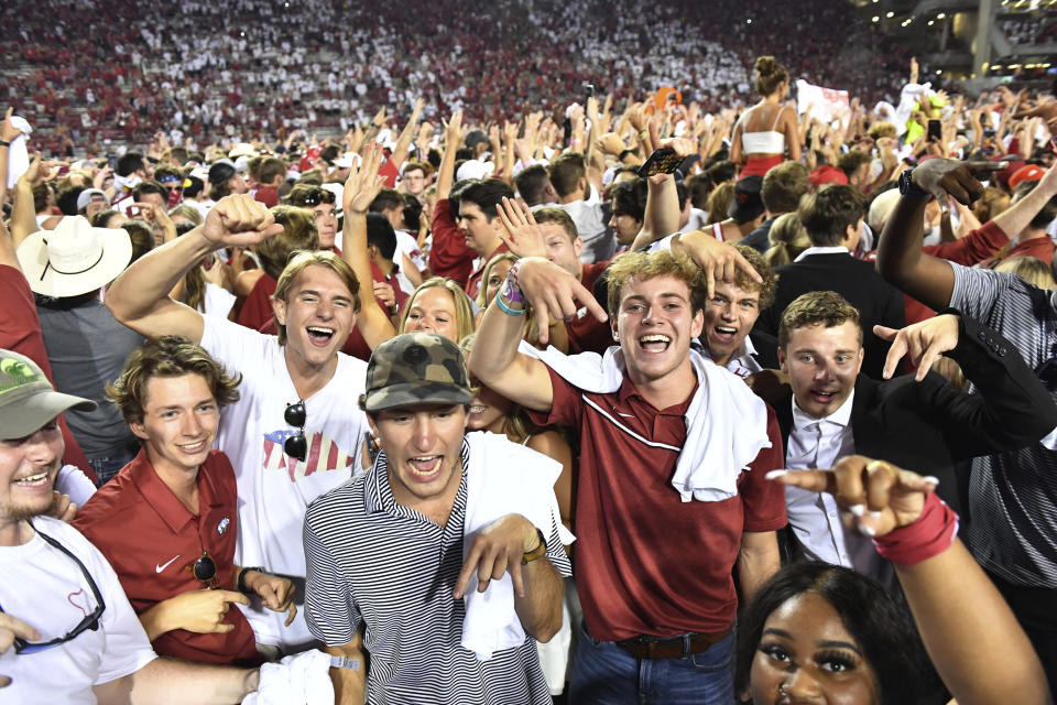 Arkansas fans celebrate the team's win over Texas in an NCAA college football game Saturday, Sept. 11, 2021, in Fayetteville, Ark. (AP Photo/Michael Woods)