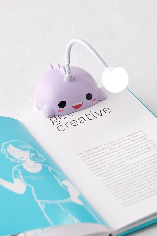 """<p>They can catch up on reading in bed with this fun <a href=""""https://www.popsugar.com/buy/Smoko-Book-Light-494414?p_name=Smoko%20Book%20Light&retailer=urbanoutfitters.com&pid=494414&price=15&evar1=savvy%3Aus&evar9=36045432&evar98=https%3A%2F%2Fwww.popsugar.com%2Fhome%2Fphoto-gallery%2F36045432%2Fimage%2F46998324%2FSmoko-Book-Light&list1=holiday%2Ccollege%2Cchristmas%2Cgift%20guide%2Cconsumerism%2Choliday%20living%2Cgifts%20under%20%24100%2Cgifts%20for%20teens%2Cunder%20%24100&prop13=api&pdata=1"""" rel=""""nofollow"""" data-shoppable-link=""""1"""" target=""""_blank"""" class=""""ga-track"""" data-ga-category=""""Related"""" data-ga-label=""""https://www.urbanoutfitters.com/shop/smoko-book-light?category=lifestyle&amp;color=050"""" data-ga-action=""""In-Line Links"""">Smoko Book Light</a> ($15).</p>"""