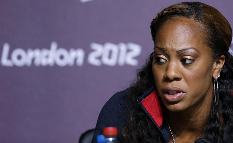 """United States runner Sanya Richards-Ross speaks during a news conference at Olympic Park during the 2012 Summer Olympics, Monday, July 30, 2012, in London. Richards-Ross is one of the U.S. athletes who are part of a Twitter campaign demanding changes in Olympic Rule 40 — which, among other things, does not permit athletes """"to promote any brand, product or service within a posting, blog or tweet or otherwise on any social media platforms or on any websites."""" (AP Photo/Matt Rourke)"""