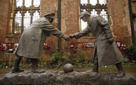 """A resin sculpture, called """"All Together Now"""", by artist Andrew Edward's is seen after being unveiled  in the remains of St Luke's Church in Liverpool"""