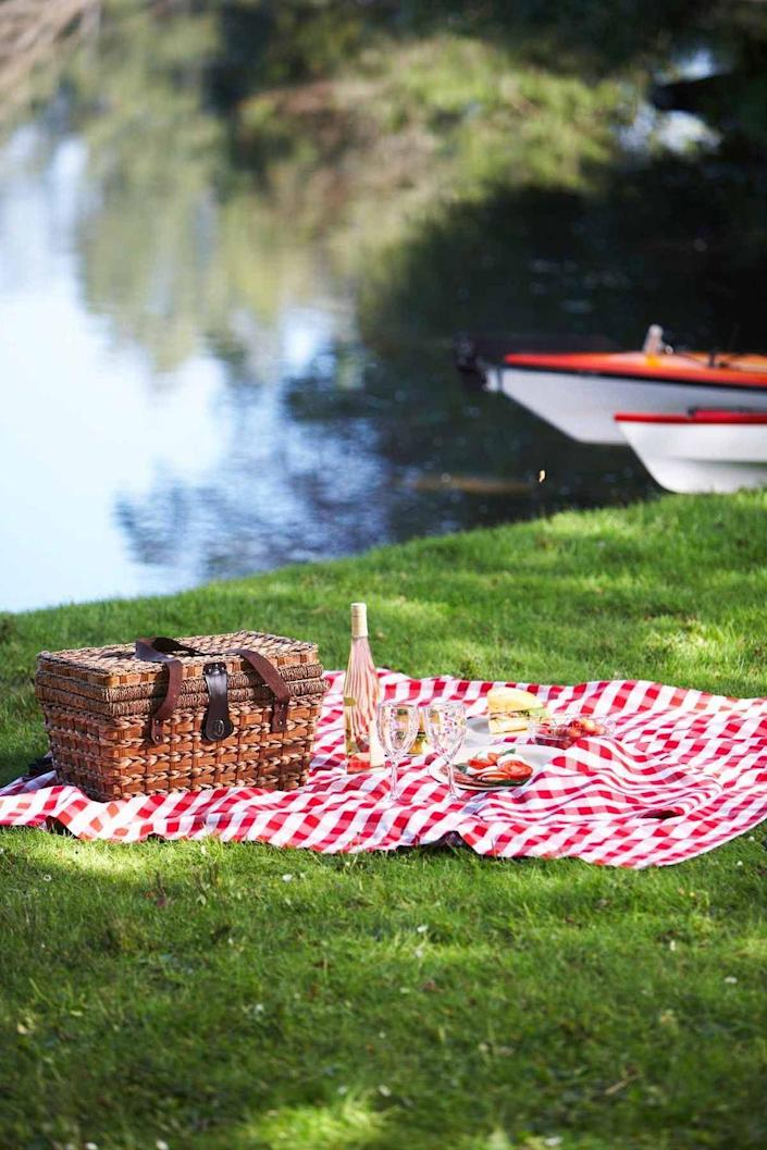"""<p>With the weather warming up, eating in the grass and under the sun is a foolproof afternoon. Plan a lunch outdoors with these <a href=""""https://www.womansday.com/food-recipes/food-drinks/g2196/picnic-food-ideas/"""" rel=""""nofollow noopener"""" target=""""_blank"""" data-ylk=""""slk:delicious picnic food ideas"""" class=""""link rapid-noclick-resp"""">delicious picnic food ideas</a>.</p>"""