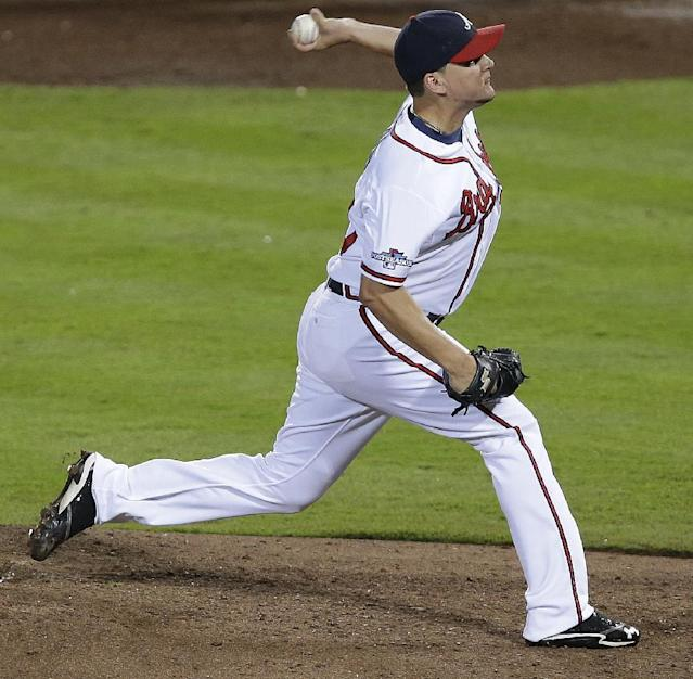 Atlanta Braves relief pitcher Luis Avilan works against the Los Angeles Dodgers in the seventh inning of Game 2 of the National League division series on Friday, Oct. 4, 2013, in Atlanta. (AP Photo/Mike Zarrilli)
