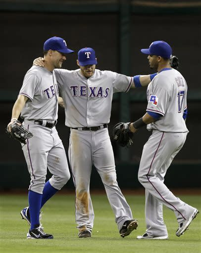 Texas Rangers David Murphy, left, Craig Gentry, center, and Nelson Cruz celebrate their 4-2 win over the Houston Astros in a baseball game Friday, May 10, 2013, in Houston. (AP Photo/Pat Sullivan)