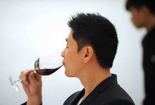 China is the world's biggest drinker of spirits, with 995 million cases guzzled in 2010