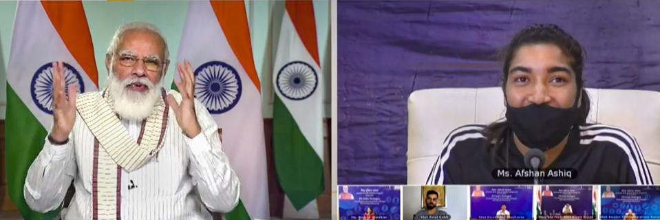 **EDS: SCREENSHOT FROM A VIDEO POSTED BY @narendramodi ON THURSDAY, SEPT. 24, 2020** New Delhi: Prime Minister Narendra Modi virtually interacts with J&K women's football team captain Afshan Ashiq along with other fitness enthusiasts during Fit India Dialogue on the first anniversary of Fit India Movement, in New Delhi. (PTI Photo)(PTI24-09-2020_000031A)