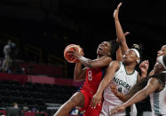 United States' Chelsea Gray (8) aims to shoot past Nigeria's Amy Okonkwo (0) during women's basketball preliminary round game at the 2020 Summer Olympics, Tuesday, July 27, 2021, in Saitama, Japan. (AP Photo/Charlie Neibergall)
