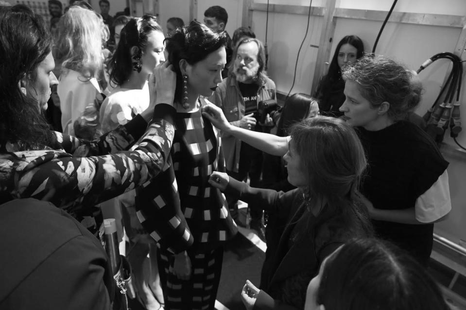 <p>Model Sora Choi gets prepped before her runway appearance.</p>