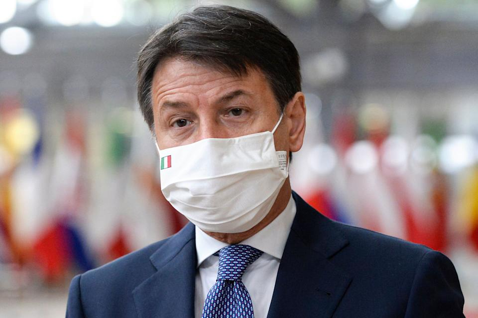 Italy's Prime Minister Giuseppe Conte speaks with the media as he arrives for an EU summit in Brussels, Friday, Oct. 16, 2020. European Union leaders meet for the second day of an EU summit, amid the worsening coronavirus pandemic, to discuss topics on foreign policy issues. (Johanna Geron, Pool via AP) (Photo: ASSOCIATED PRESS)