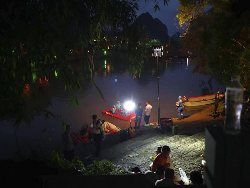 Rescuers search for missing boaters into the night after two dragon boats capsized in southern China, killing seventeen people (Chinatopix via AP)