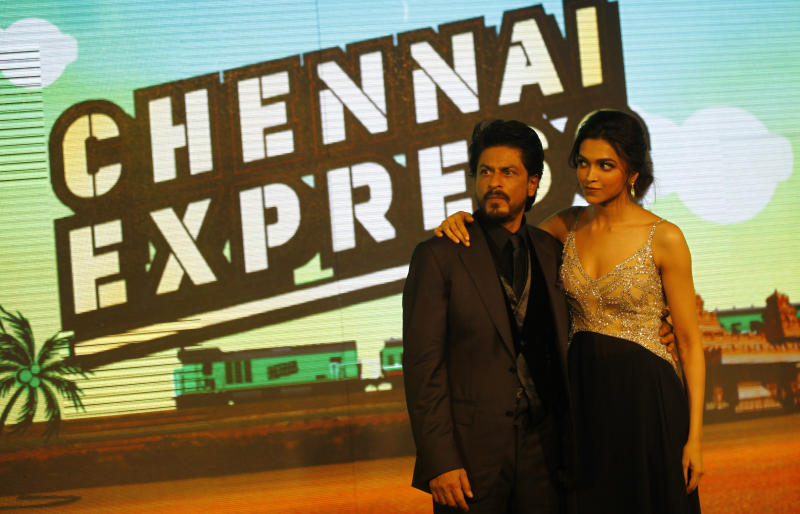 "Bollywood star Shah Rukh Khan, left posses for a picture with co actor Deepika Padukone during the music release for his upcoming movie ""Chennai Express"" in Mumbai, India, Wednesday, July 3, 2013. Directed by Rohit Shetty, the film scheduled for release on August 8 features Khan and Padukone in lead roles. (AP Photo/Rafiq Maqbool)"