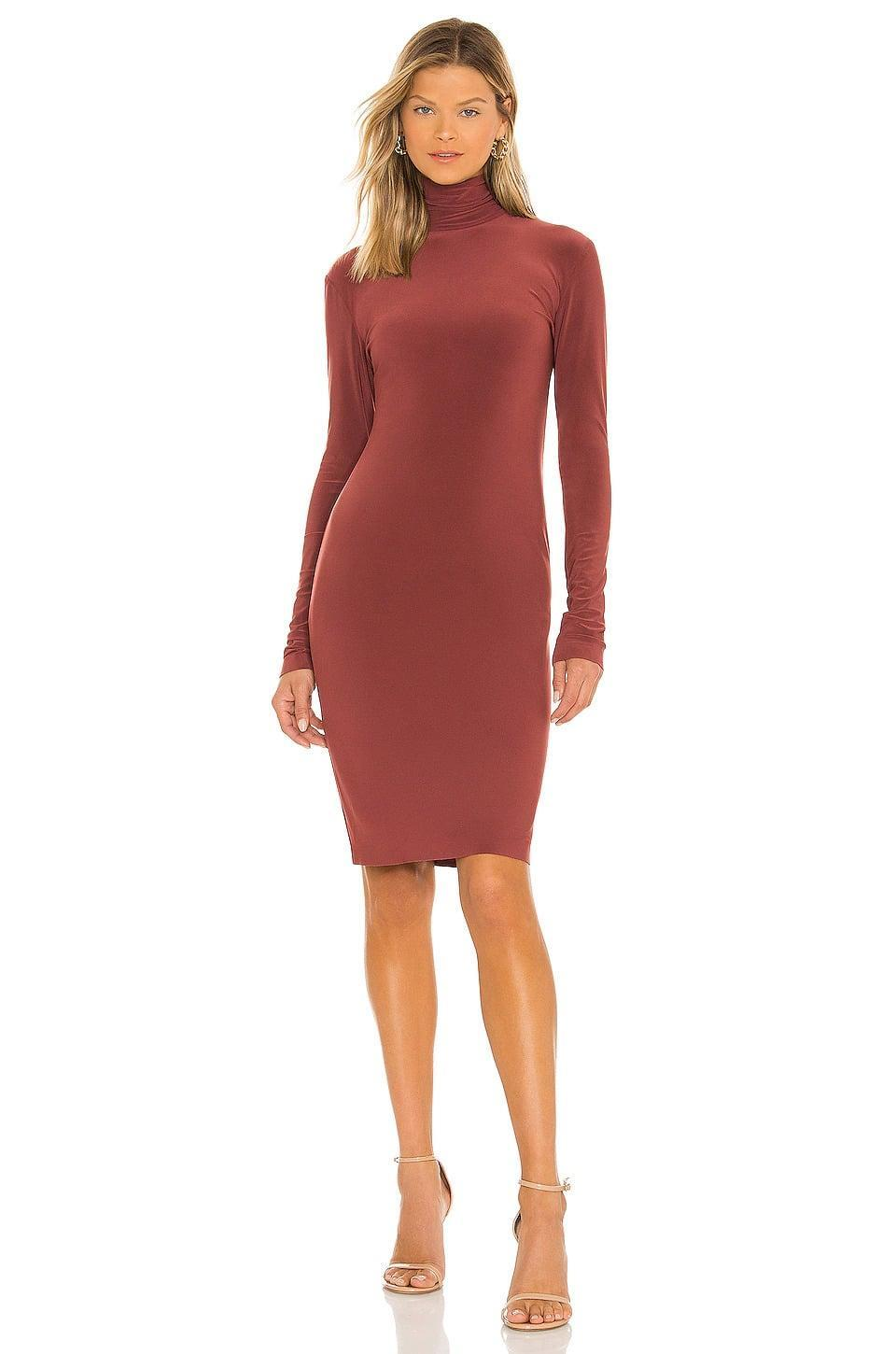 <p>Look stylish without sacrificing warmth in this <span>Norma Kamali Long Sleeve Turtleneck Dress in Copper</span> ($125). The color is divine, the silhouette is ultra-flattering, and it'll keep us warm during the colder months. </p>
