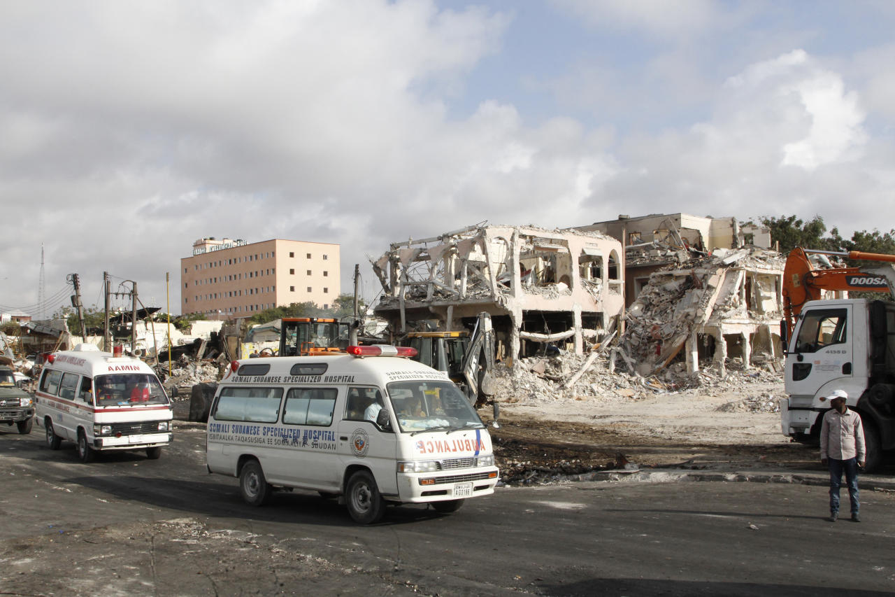 <p>Ambulances carrying wounded victims passes the scene of Saturday's truck bomb blast, as they head to airport to be airlifted by Turkish air ambulance for treatment in Turkey, in Mogadishu, Somalia, Oct,16, 2017. (Photo: Farah Abdi Warsameh/AP) </p>