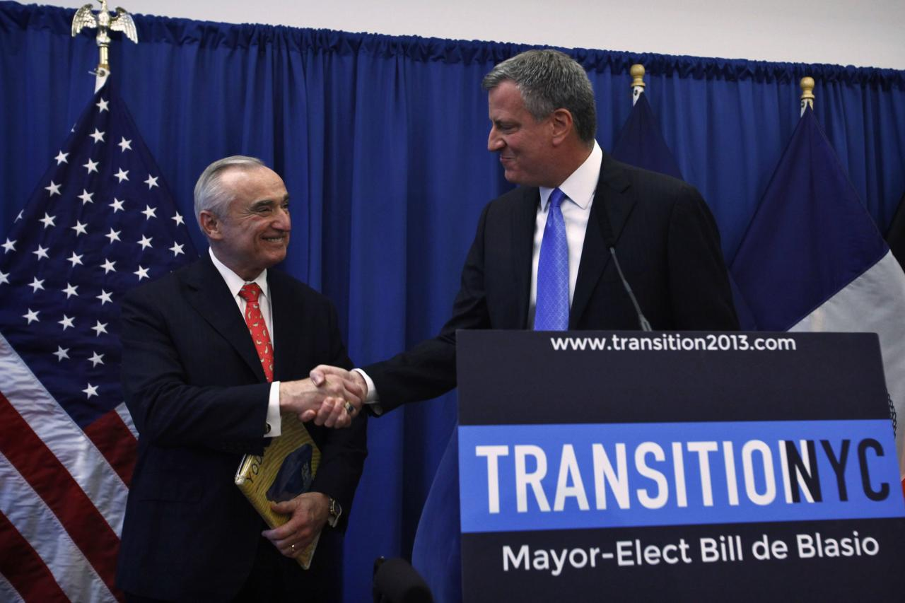 New York Mayor-elect Bill de Blasio (R) shakes hands with veteran police chief Bill Bratton during a news conference in Brooklyn, New York, December 5, 2013. Bratton has led departments across the country, was named on Thursday as New York City's next police commissioner, taking over a force credited with a sharp drop in violent crime but criticized for its tactics. REUTERS/Eduardo Munoz (UNITED STATES - Tags: POLITICS CRIME LAW TPX IMAGES OF THE DAY)