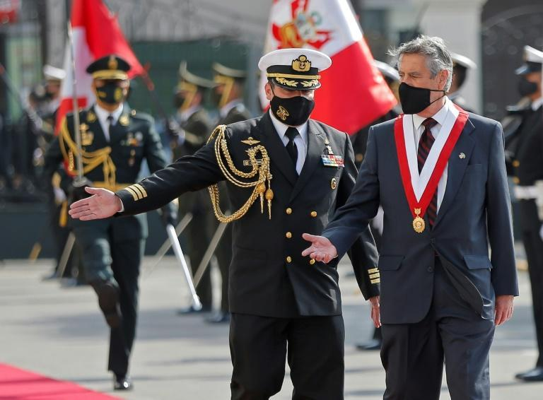 Newly appointed Peruvian interim President Francisco Sagasti is scorted by a military attache upon his arrival at the Congress building in Lima on November 17, 2020, for his swearing-in ceremony
