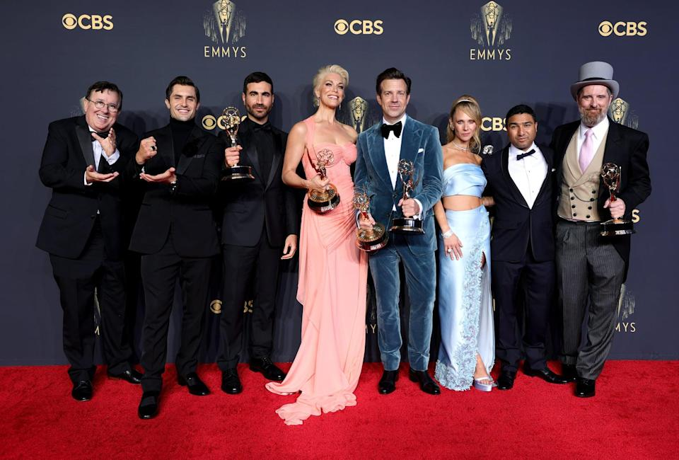 LOS ANGELES, CALIFORNIA - SEPTEMBER 19: (L-R) Jeremy Swift, Phil Dunster, Brett Goldstein, Hannah Waddingham, Jason Sudeikis, Juno Temple, Nick Mohammed, and Brendan Hunt, winners of Outstanding Comedy Series for 'Ted Lasso,' as well as Outstanding Supporting Actor in a Comedy Series (Goldstein), Outstanding Supporting Actress in a Comedy Series (Waddingham), and Outstanding Lead Actor in a Comedy Series (Sudeikis), pose in the press room during the 73rd Primetime Emmy Awards at L.A. LIVE on September 19, 2021 in Los Angeles, California. (Photo by Rich Fury/Getty Images)