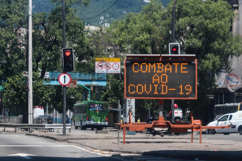 Traffic signs display messages against Coronavirus Covid-19 in downtown Rio de Janeiro, Brazil, on March 25, 2020. (Photo by Luiz Souza/NurPhoto via Getty Images)