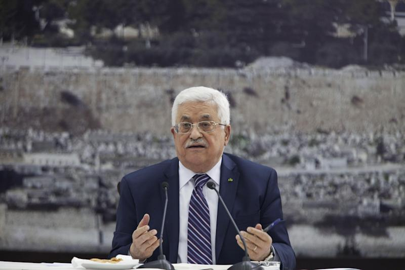 """Palestinian President Mahmoud Abbas talks during a leadership meeting in Ramallah, Tuesday, April 1, 2014. In a dramatic move that could derail eight months of U.S. peace efforts, President Abbas resumed a Palestinian bid for further U.N. recognition despite a promise to suspend such efforts during nine months of negotiations with Israel. Abbas signed """"State of Palestine"""" applications for 15 U.N. agencies in a hastily convened ceremony after Israel calls off a promised prisoner release. (AP Photo/Majdi Mohammed)"""