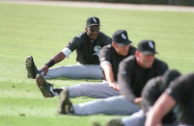 Michael Jordan stretches during the first day of the Chicago White Sox spring training workouts, Saturday, Feb. 18, 1995, Sarasota, Fla. (AP Photo/Pat Sullivan)