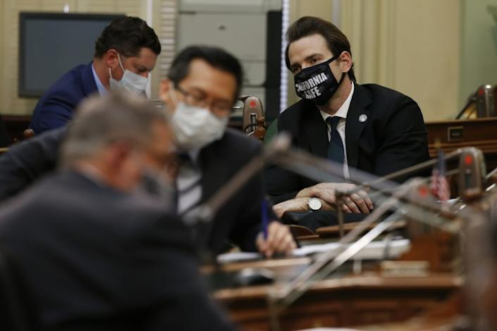 """Assemblyman Kevin Kiley, right, R-Granite Bay, attends a hearing of the Assembly Transportation Committee in Sacramento, Calif. <span class=""""copyright"""">(Rich Pedroncelli/AP)</span>"""