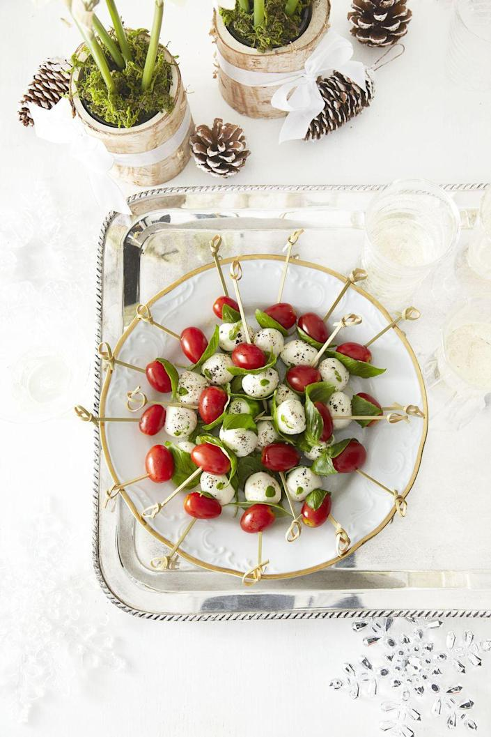 """<p>Mozzarella makes a perfect keto popper! Dressed with a little balsamic and spiked alongside tomato and fresh basil, this vegetarian kabob feels elevated and light.</p><p><a href=""""https://www.goodhousekeeping.com/food-recipes/a13678/tomato-mozzarella-bites-recipe-ghk1212/"""" rel=""""nofollow noopener"""" target=""""_blank"""" data-ylk=""""slk:Get the recipe for Tomato and Mozzarella Bites »"""" class=""""link rapid-noclick-resp""""><em>Get the recipe for Tomato and Mozzarella Bites <em><em>»</em></em></em></a></p>"""