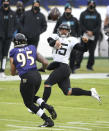 Jacksonville Jaguars quarterback Gardner Minshew II (15) throws a pass as Baltimore Ravens defensive end Derek Wolfe (95) applies pressure during the second half of an NFL football game, Sunday, Dec. 20, 2020, in Baltimore. (AP Photo/Nick Wass)